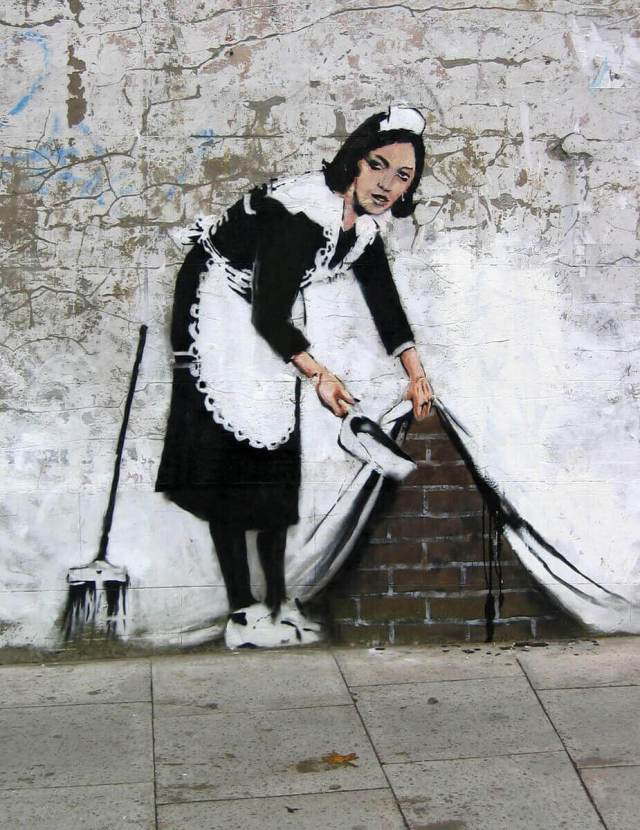"Banksy. Graffiti ""Sweeping This Under the Carpet"""