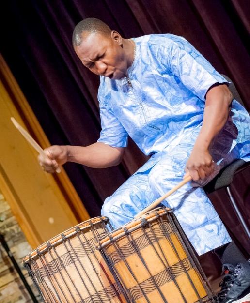 Sidi Joh Camara, newly named a Mass Cultural Council Traditional Arts Fellow, plays percussion at the Shalin Liu Performance Center in Rockport, May 2017.