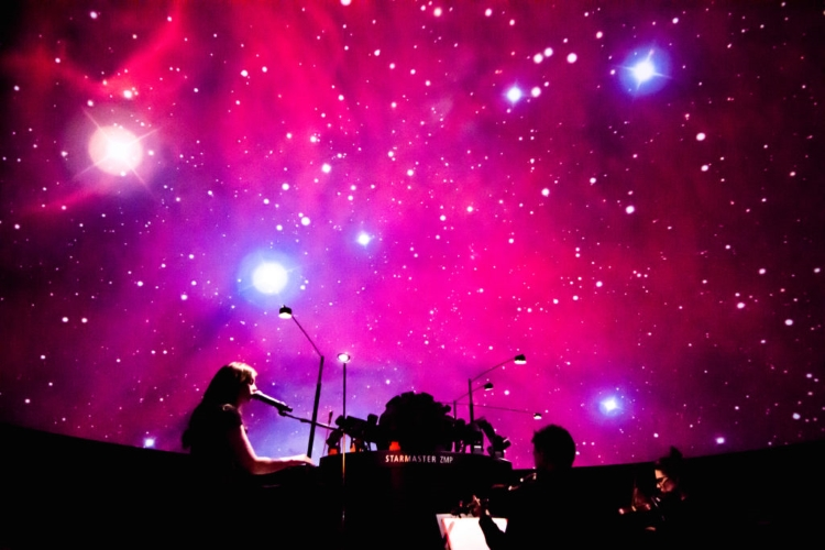 Mary Bichner performing SYNESTHESIA SUITE: CONSTELLATIONS at Boston's Museum of Science, photo by Jonathan Beckley.
