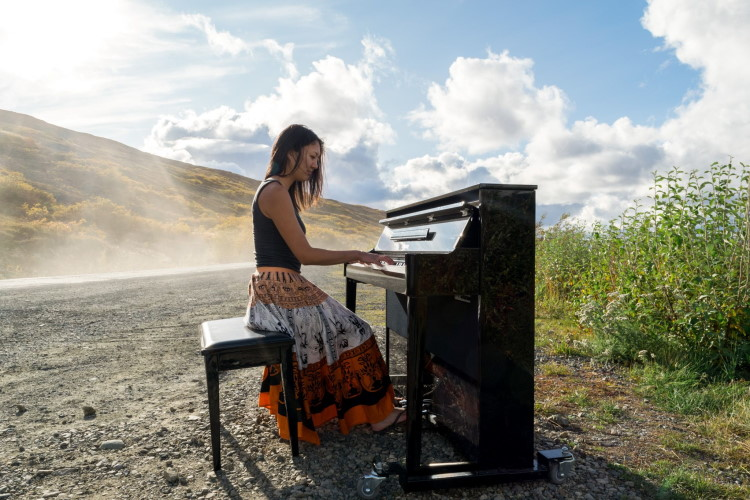 Miki Sawada traveling on the Denali Highway with piano, 2017, photo by Andrew Rizzardi.