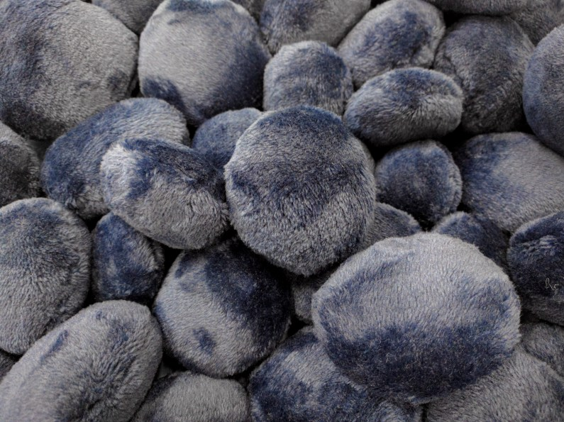 Artist Yuen-Ying Lam invites you to touch these soft pebbles in To Hold and Be Held at artsdepot