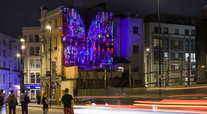 Artist Dan Kitchener kicks off night time street scenes of low light art murals
