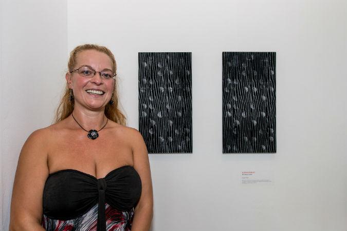 BA Hones Textiles graduate Ildiko Hurley with her work in the BOSS exhibition
