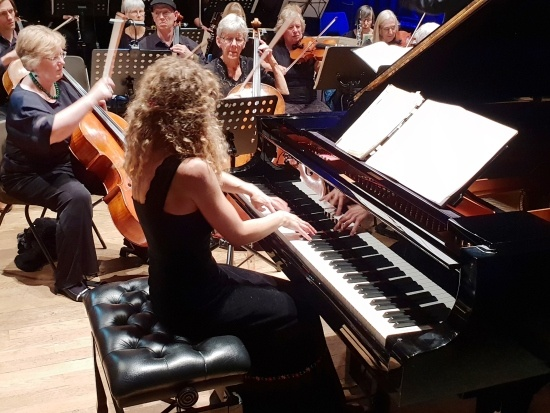 Torbay Symphony Orchestra Veronika Shoot sitting at grand piano