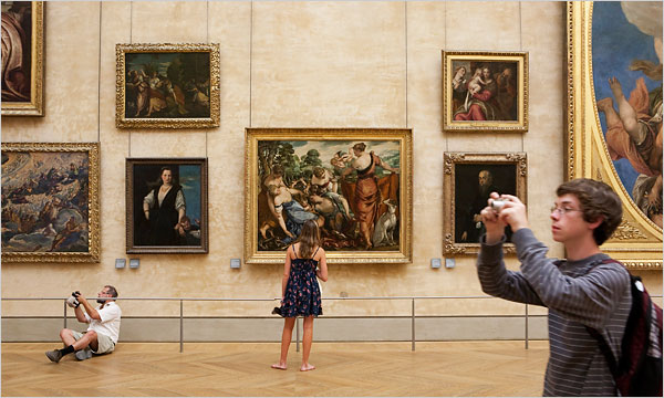 Visitors at the Louvre Museum via The New York Times