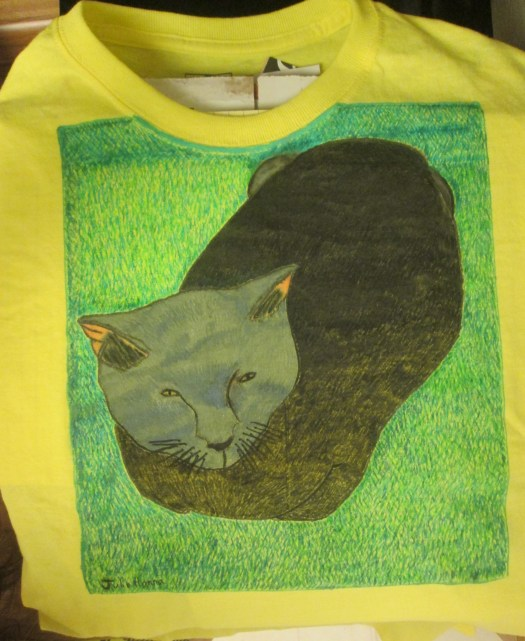 The shirt with the completed fabric marker drawing of Irina the cat.