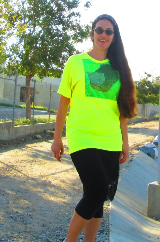 I wore the neon yellow cat shirt with a black lacy pencil skirt and capri leggings