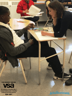 Sarah assisting a student with his artwork
