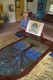 Sarah Craige in studio with Tree of Life artwork