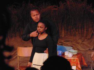 Ayanda (Tiisetso Mashifane) being hypnotised by the preacher (Sisesakhe Ntlabezo). Photo: Thato Tsotetsi / Artsvark