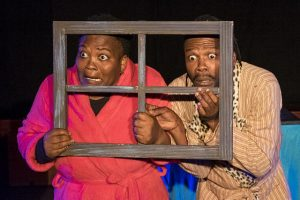 Nox Donyeli and Sisonke Yafele looking through a window during the production of Langa Yanta- Monster Hunter on 30 June 2016, in the National Arts Festival, in The Oatlands School Hall in Grahamstown, South Africa. The production was directed by Kyla Davis. (Photo: CuePix/Megan Moore)
