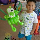 Happy boy with balloon dragon
