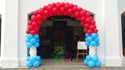 Special red and blue balloon arch