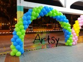green and blue balloon arch