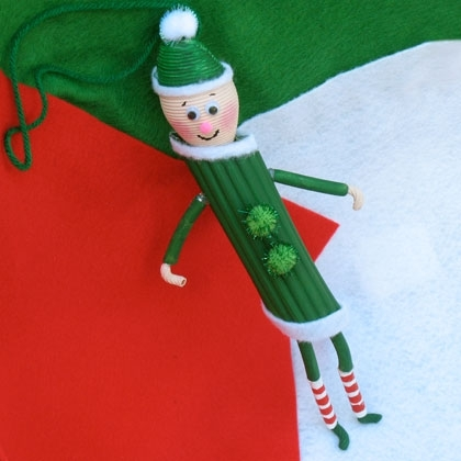 pasta-elf - 13 Easy Christmas Ornaments for Kids to make with pasta - Pasta angels, pasta elf, pasta gingerbread house, fun and easy pasta ornament craft ideas.