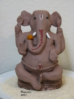 Handmade clay ganesha , eco friendly - via ArtsyCraftsyMom.com - Ganesh Chaturthi Crafts and Activities to do with Kids - Make a Clay Ganesha, decorate, Ganesha's throne & umbrella, rangoli ideas, recipes, books and more