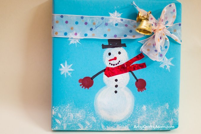 Homemade Christmas wrapping paper Sponge Stamped Snowman Craft