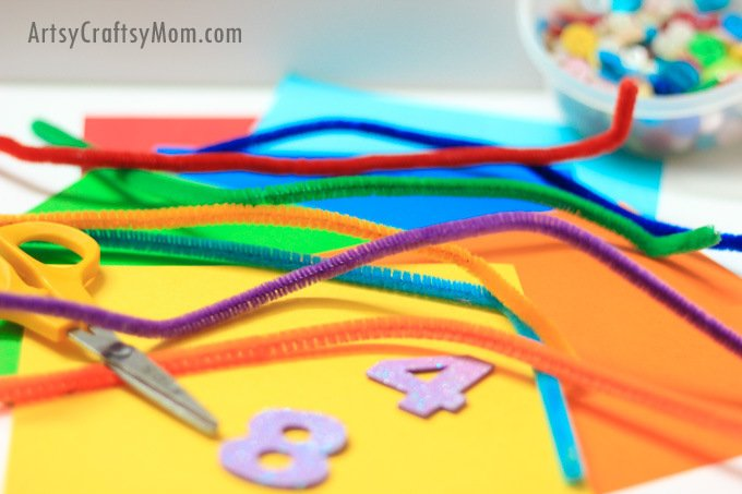 Umbrella Counting & Color Sort - What a brilliant STEM idea for your toddler/preschooler to celebrate Umbrella Day. Use as Letter U craft, Spring craft or even when yu are holed up inside on a rainy day. This simple activity promotes fine-motor skills and color recognition!