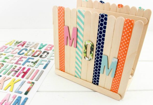Have fun with these Mother's Day Crafts to Make with Craft Sticks! Make a Popsicle stick photo frame, an earring holder, a coaster, or even a holder for Mom's beloved recipes!