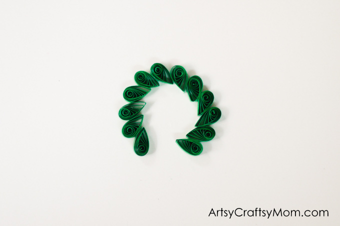 Wreaths are an integral part of Christmas decor! Make your own little version with this Paper Quilled Wreath - an easy Christmas ornament for your tree!