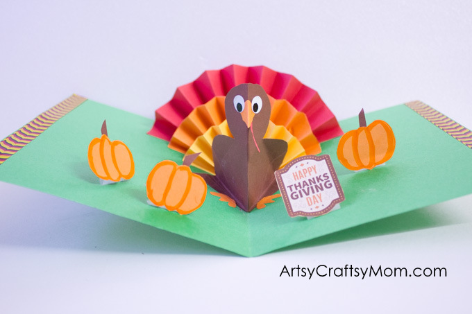 DIY Thanksgiving Turkey Popup Card - Here's an easy accordion fold turkey craft that pops right up to wish kids a Happy Thanksgiving Day!