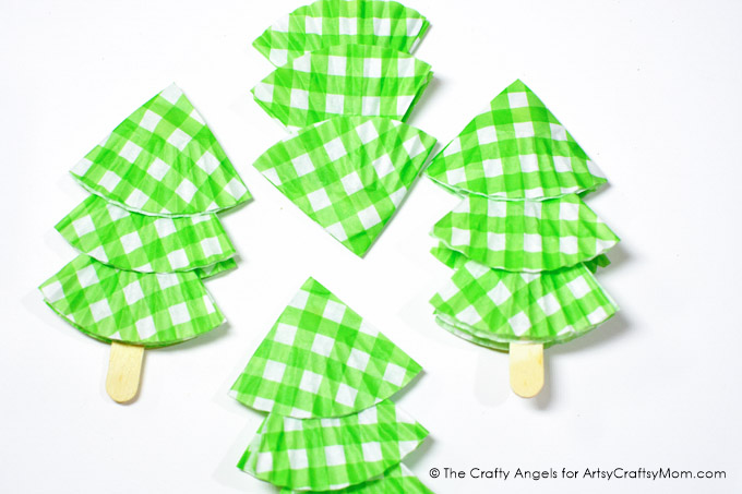 Finished putting the final touches on your tree? If not, then here's a Cute DIY Cupcake Liner Tree Christmas Ornament to add that perfect handmade touch!