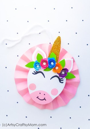 Make your Christmas tree even more magical with a DIY Unicorn Paper Ornament!! With craft paper, beads and glitter, this craft is a breeze to make!