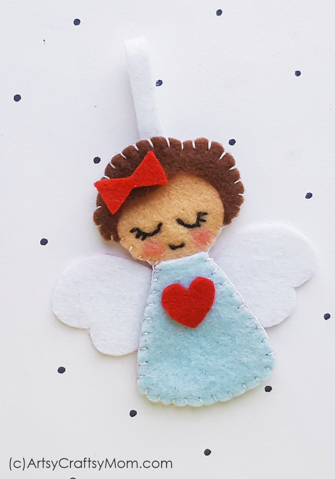 Add a heavenly touch to your Christmas decorations with this cute little Felt Angel Christmas Ornament. Make them in different colors!