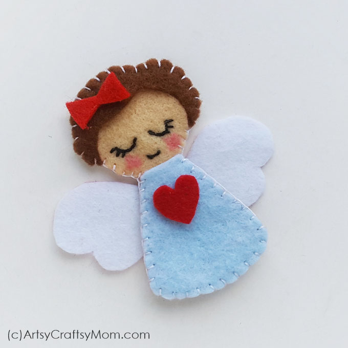 Add a heavenly touch to your Christmas decorations with this cute little Felt Angel Christmas Ornament. Make them in different colors to gift or keep!