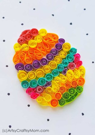 Colorful Easter eggs are the most identifying feature of this holiday! Make your own with this easy and bright Paper Quilling Easter Egg Craft!