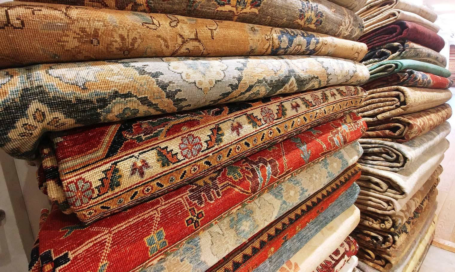 oriental area rug stack at artsy rugs