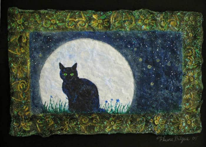 Black cat against a full moon