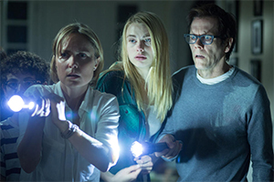 It's not a horror movie, it's a horrible movie! Radha Mitchell, Lucy Fry and Kevin Bacon star in director Greg McLean's awful The Darkness, in theaters this week.
