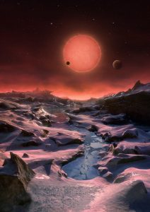 This artist's impression shows an imagined view from the surface one of the three planets orbiting an ultracool dwarf star just 40 light-years from Earth that were discovered using the TRAPPIST telescope at ESO's La Silla Observatory. These worlds have sizes and temperatures similar to those of Venus and Earth and are the best targets found so far for the search for life outside the Solar System. They are the first planets ever discovered around such a tiny and dim star. In this view one of the inner planets is seen in transit across the disc of its tiny and dim parent star.