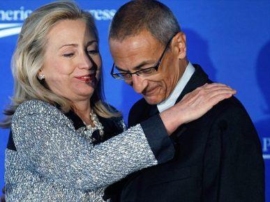 Hillary Clinton and John Podesta. Both had ties to Russia.