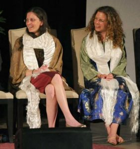 On stage with the Dalai Lama. How much it cost the two heiresses for this moment is anybody's guess.