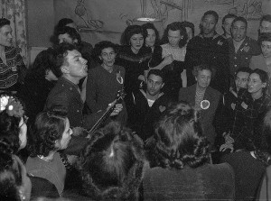 Pete Seeger, noted folk singer entertaining at the opening of the Washington labor canteen, with Eleanor Roosevelt