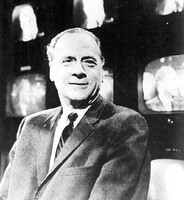 Black and White image of Marshall McLuhan in front of TV screens