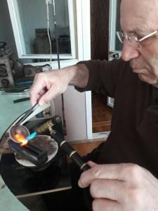 Garen working on armenian handmade pendants
