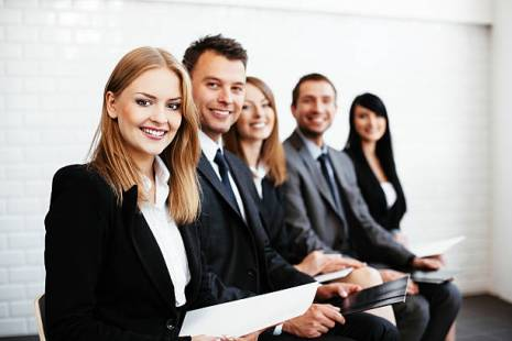 Business people smiling - How to Hire the Best People for the Job