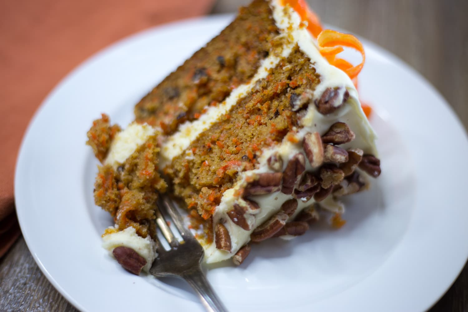 Moist carrot cake with cream cheese frosting, pecans, and crunchy candied carrots is my new favorite dessert! |artzyfoodie.com|