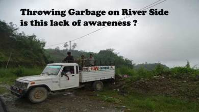 Photo of Throwing Garbage in River side, lack of Awareness ?