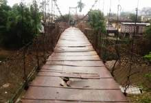 Photo of Itanagar: Suspension Bridge over Singki river barely hanging