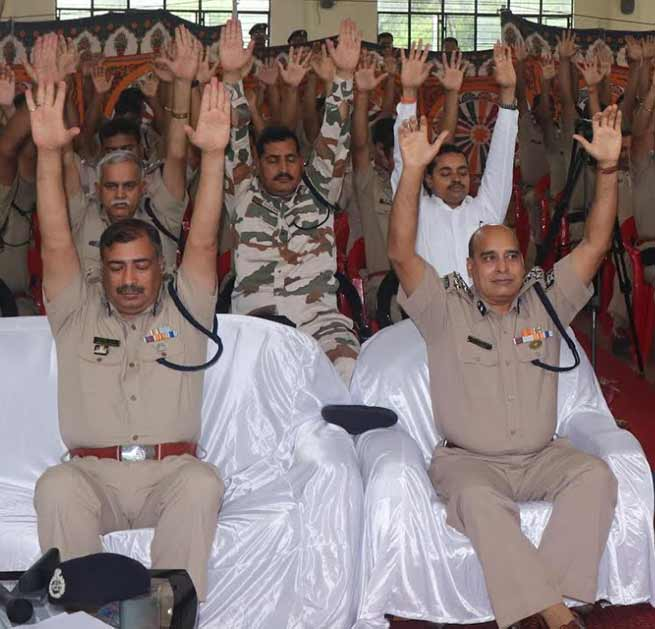 International Yoga Day- ITBP officials practicing yoga in uniform, boot and belt on waist