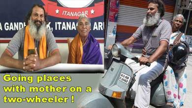 "Photo of Mother-son on ""India Darshan"" on 20-years-old scooter"