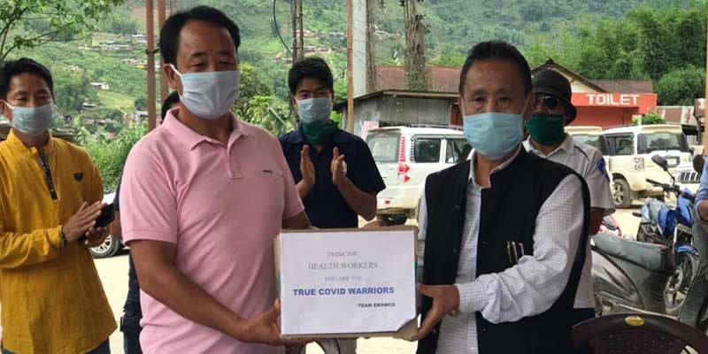 Arunachal:EKSWCO donates sanitizer and PPE kits