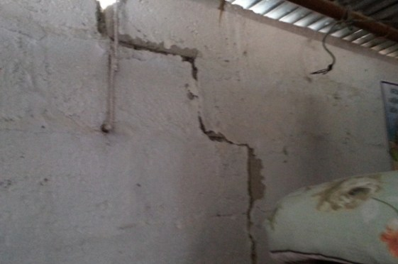 still living in earthquake ravaged homes to seek shelter from monsoon rain.