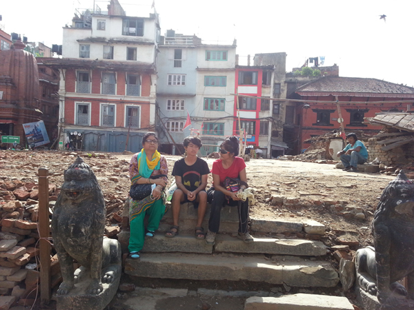 Surrel! Sitting in silence, 3 generations, mom & son and grandma.  Just watching where once stood Kasthamandap in its glory and now nothing but rubble. We just took it in barely speaking, just watching in silence.  This is the heart of where I was born!