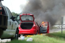 Fire and smoke engulfing the car