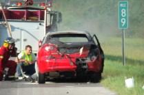 Firemen inspecting the car